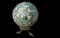 Mosaic globe on dragon stand